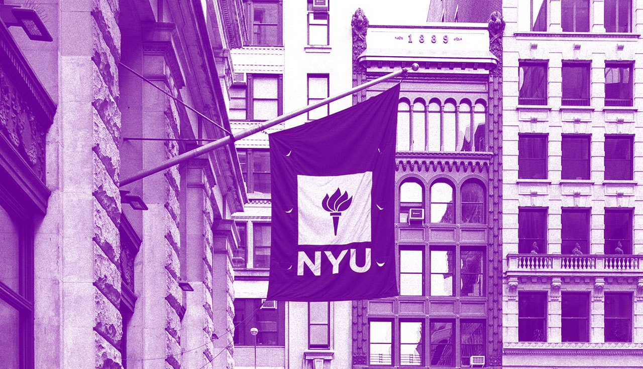 An NYU flag hanging from a building.